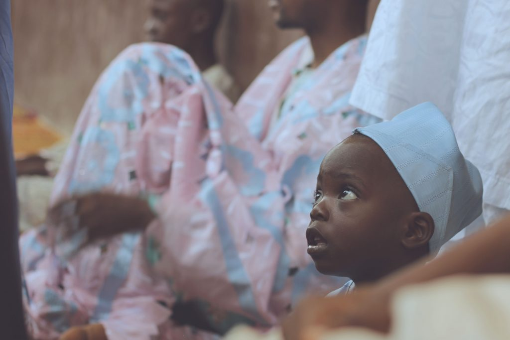 Child at ceremony in Ikorodu, Nigeria. Photo by Oshomah Abubakar on Unsplash